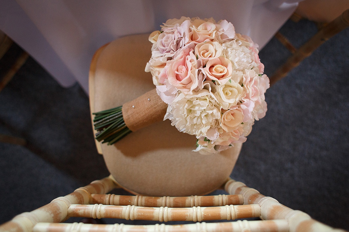 the brides flowers left on her chair inside the barn