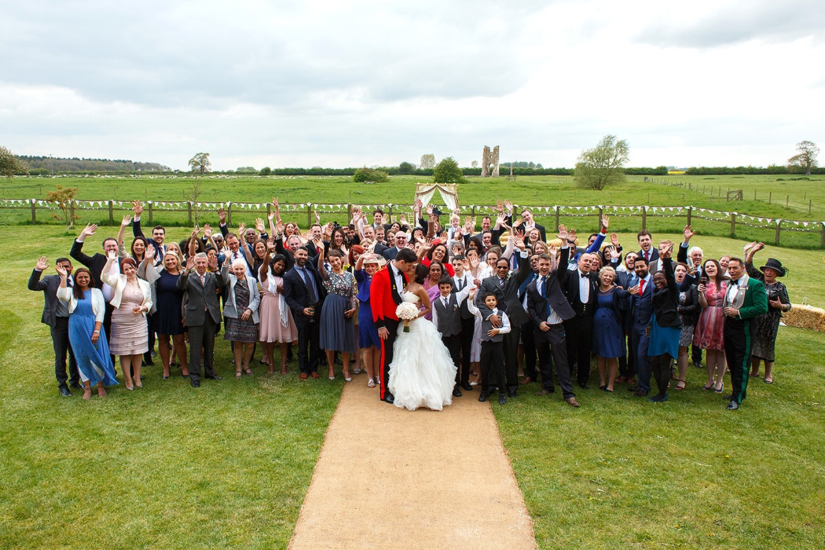 a group photo of everyone at a godwick barn wedding