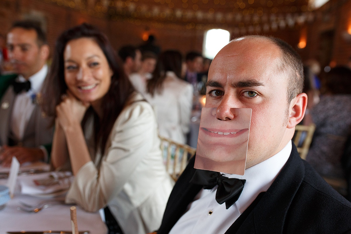 a wedding guest pulling a silly face