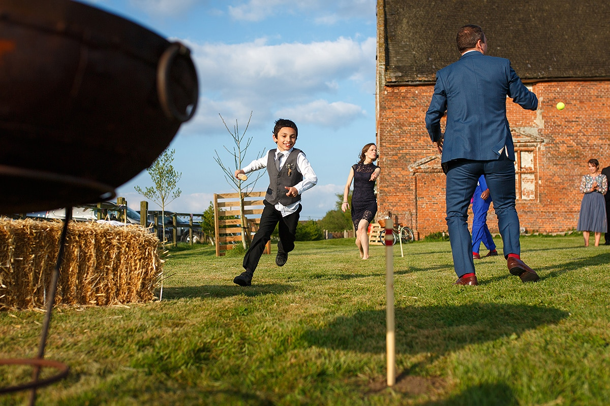 guests play rounders outside godwick barn