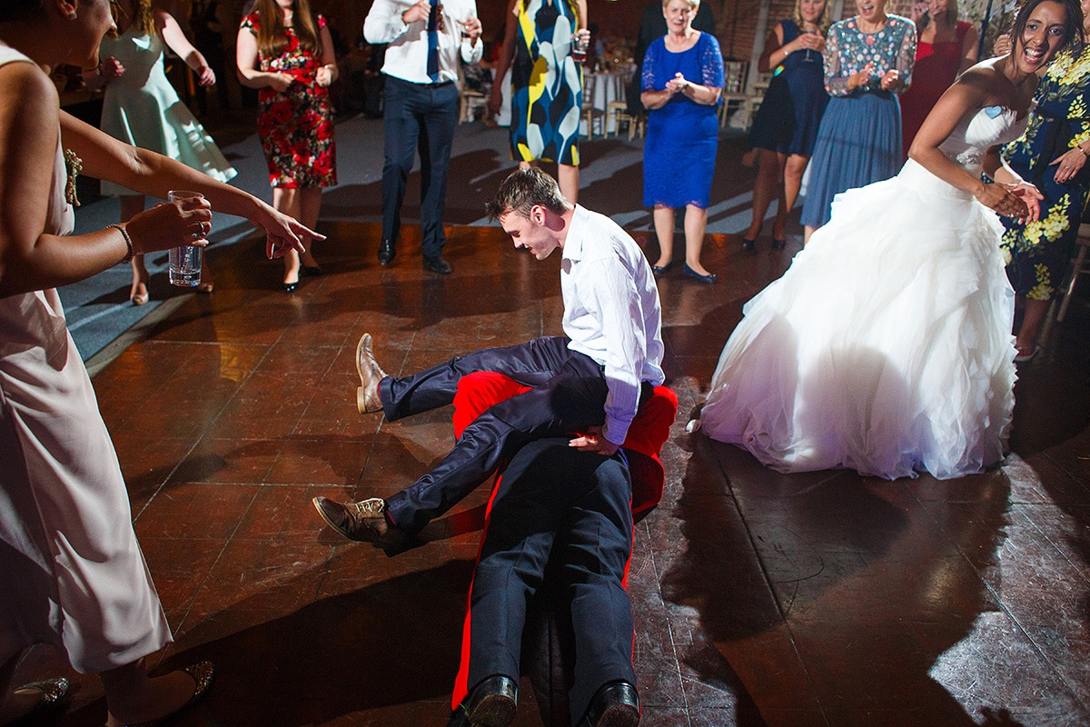 a guest sits on rob on the dance floor
