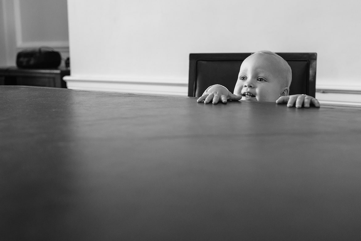 a baby looking over the ceremony table
