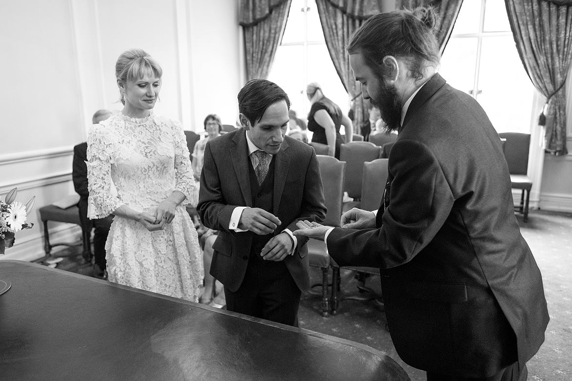 the best man hands david the wedding ring