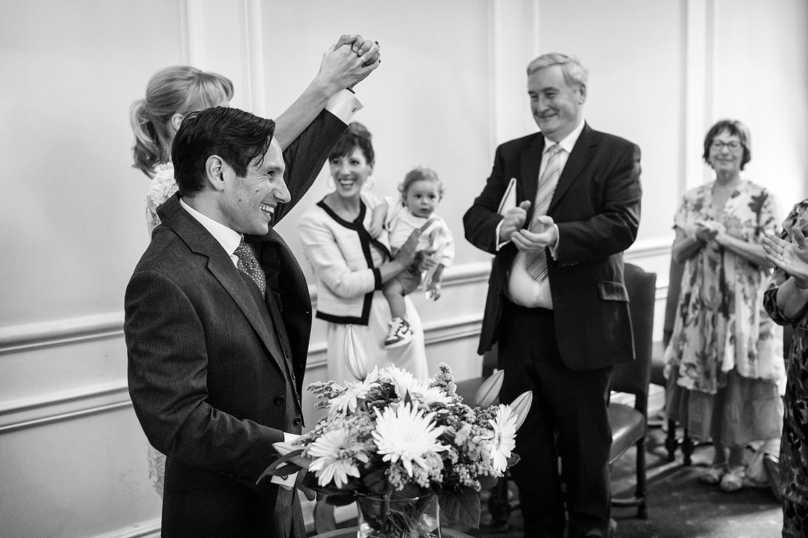 a happy bride and groom at marylebone town hall