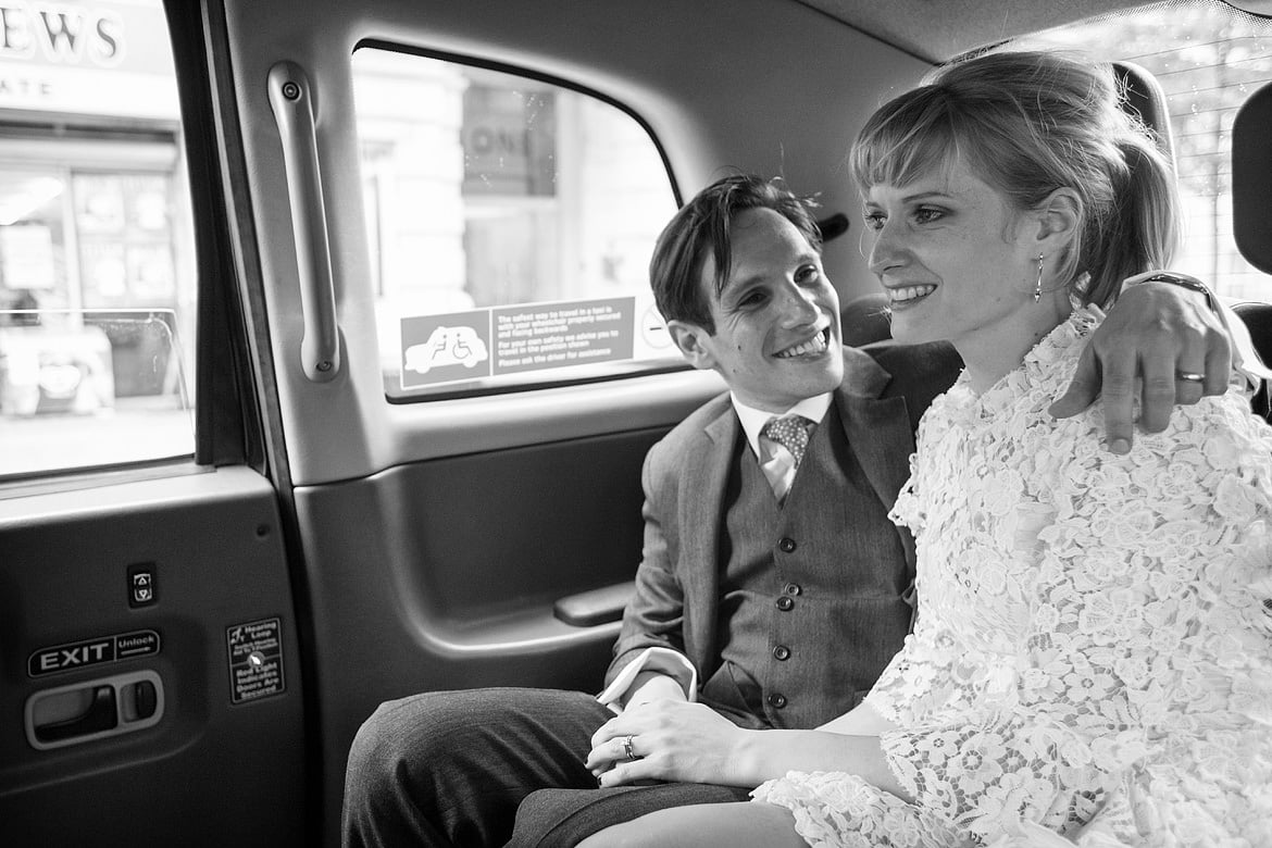 bride and groom in the taxi