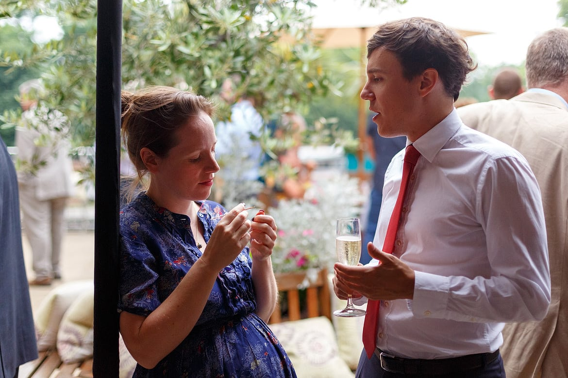 two wedding guests chatting