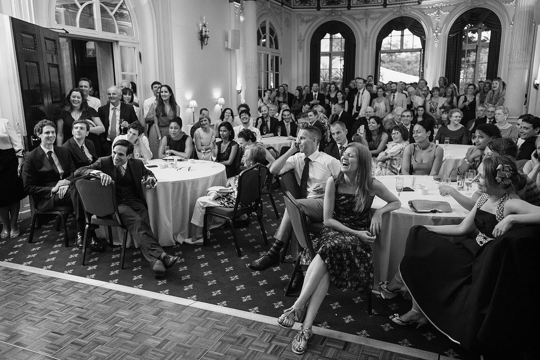 wide shot of the wedding guests enjoying rowenas speech