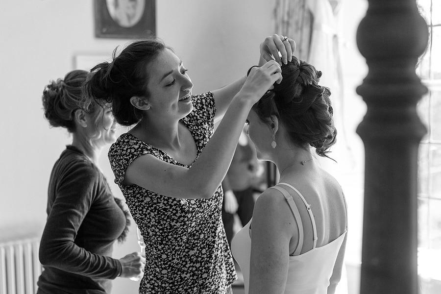 laura fixes a bridesmaids hair