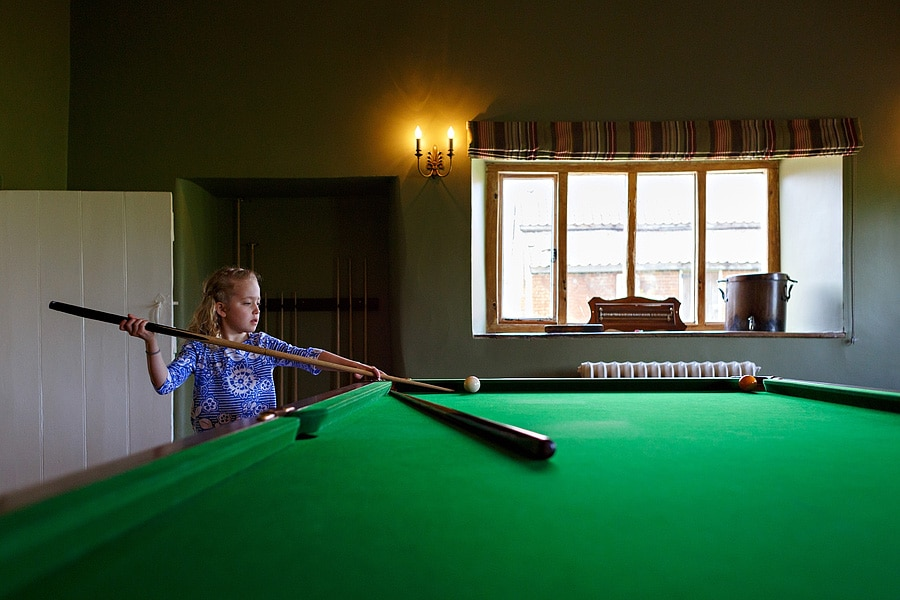 one of the flowergirls plays snooker