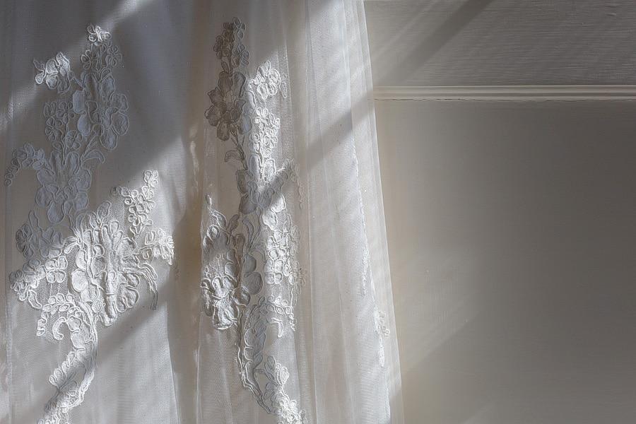 light falling onto the brides dress