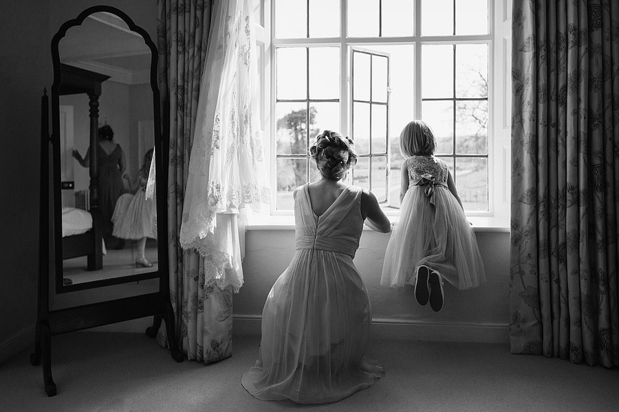 a flowergirl looks out of the window