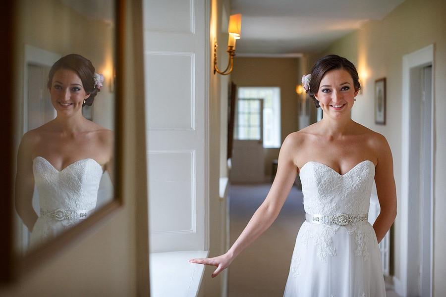 the bride posing in the hallway at Bruisyard Hall