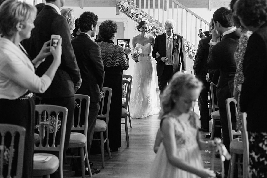 bride and father enter the ceremony room
