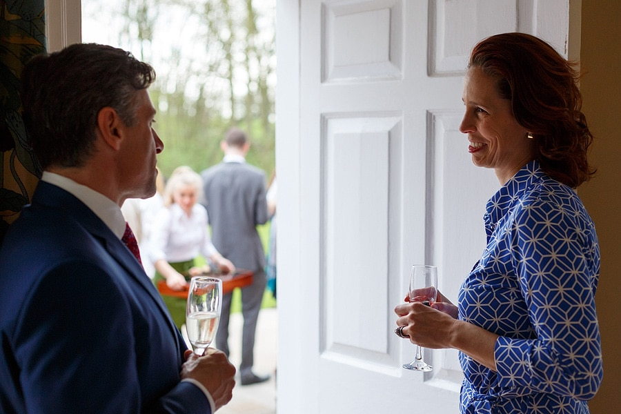 guests chat in a doorway