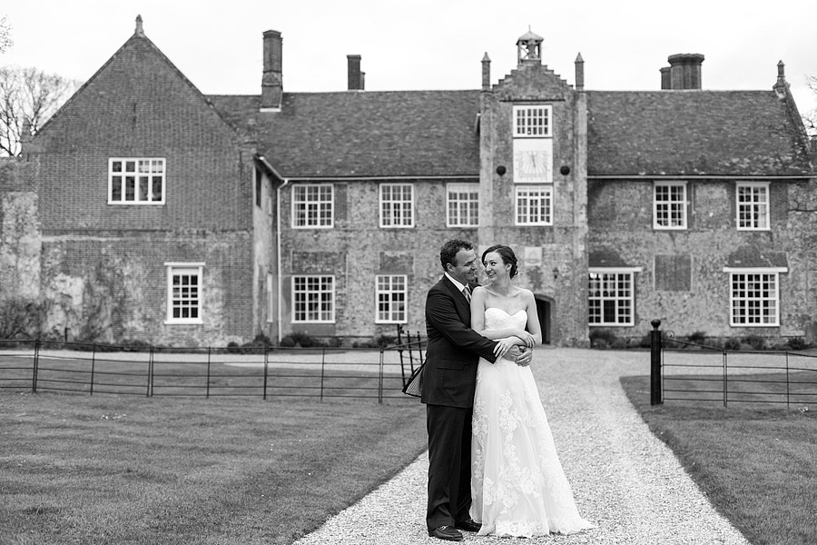 laura and brooks pose in front of bruisyard hall