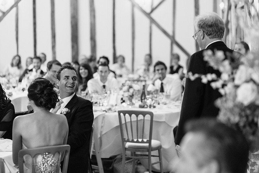 the groom laughs at the father of the brides speech