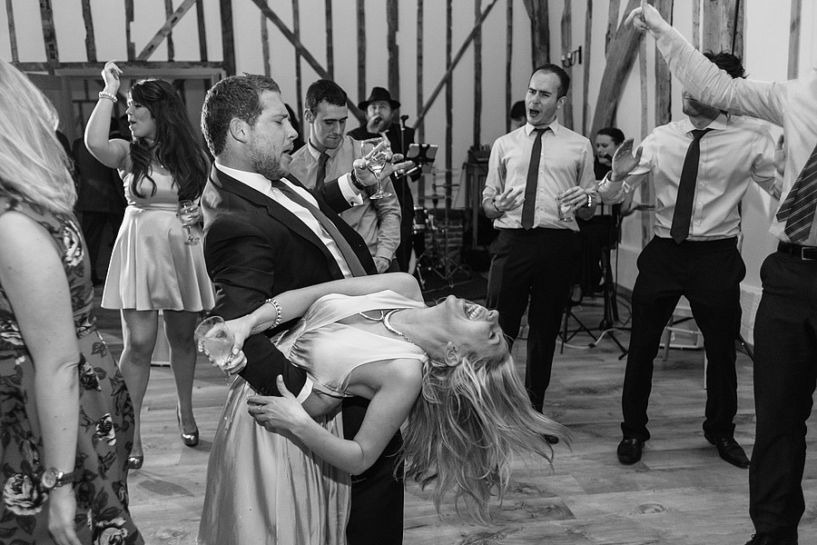 bride and groom dance in front of the band