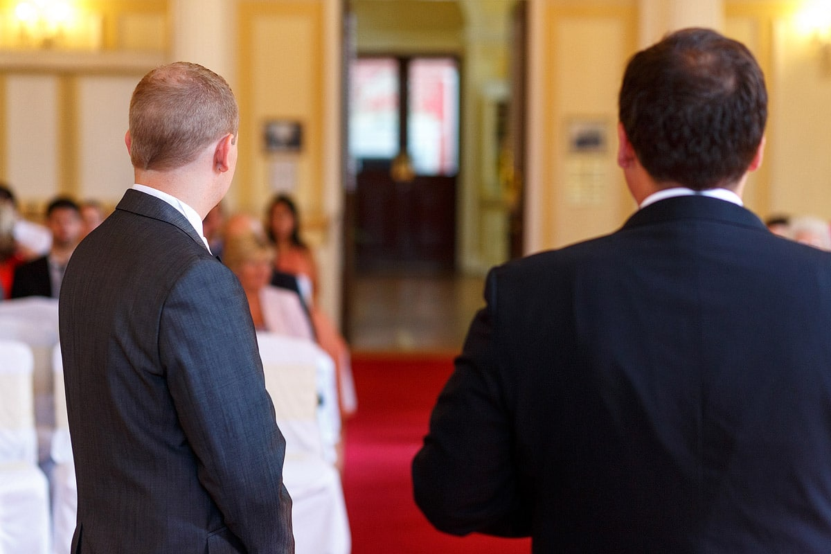 the groom and best man wait for the brides entrance