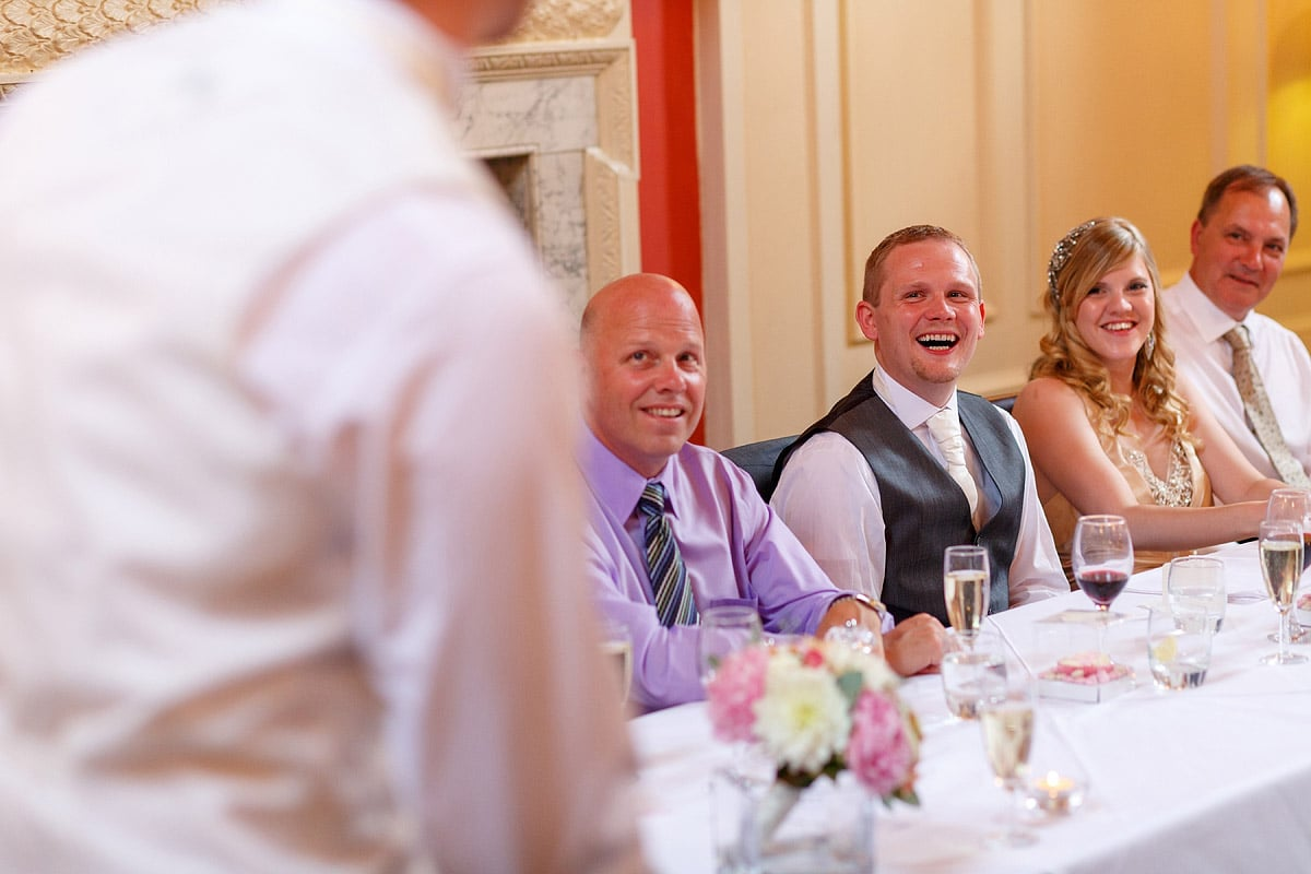 the groom laughs at the best mans speech