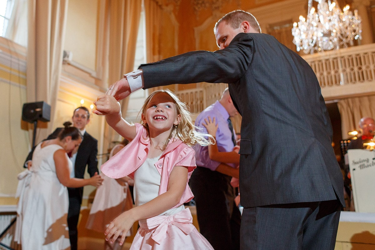 the groom dances with a flowergirl