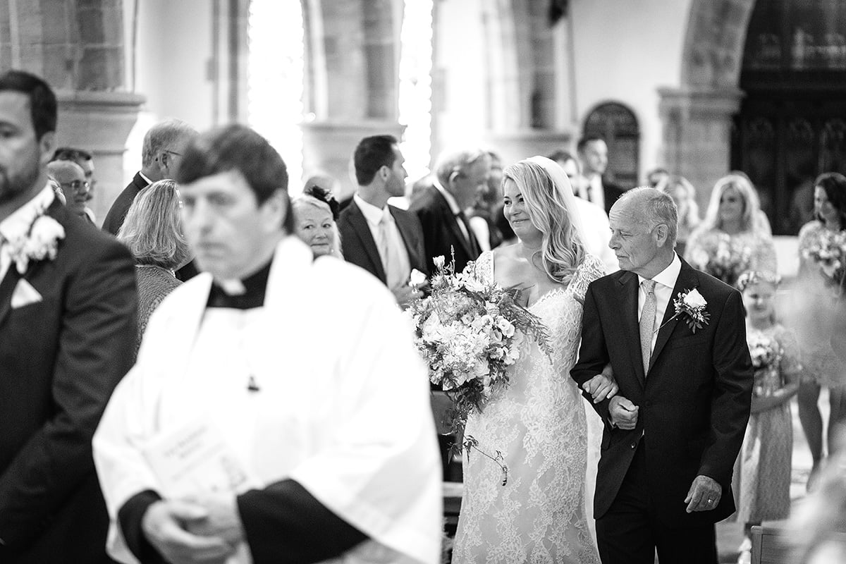 laura and her father walk down the aisle