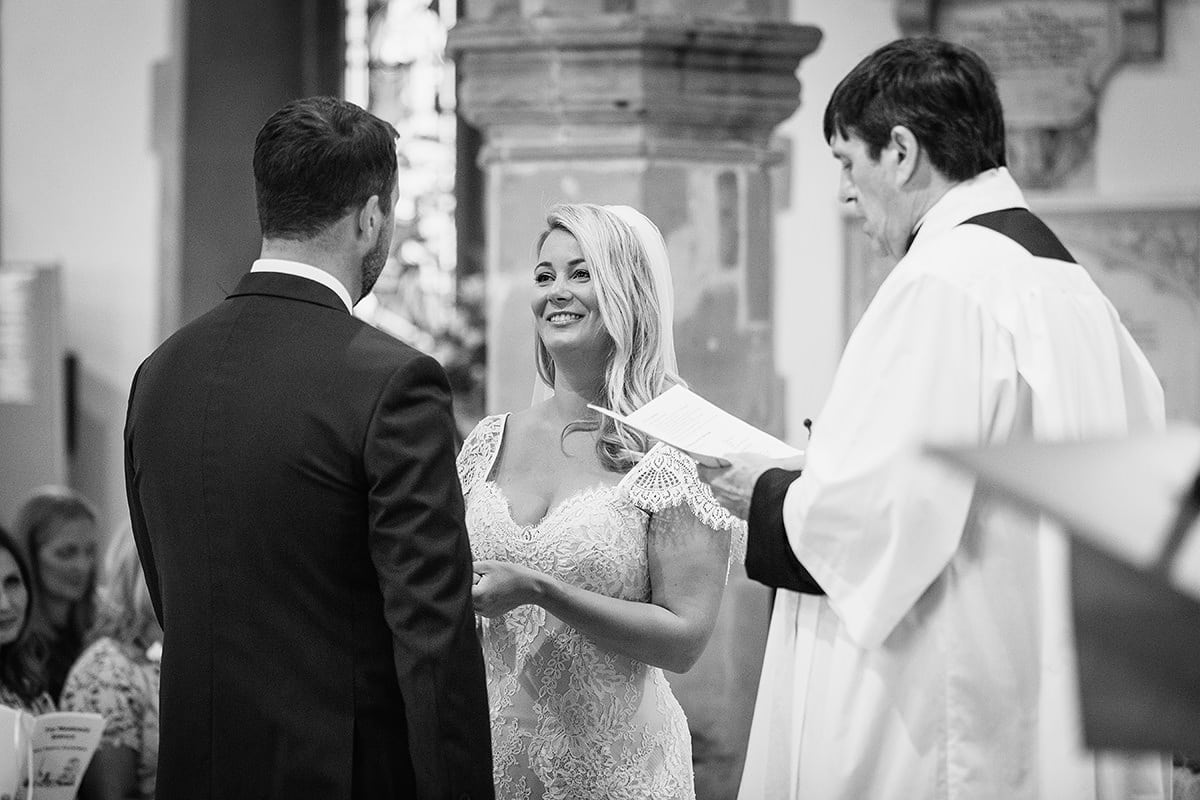 the bride gives the groom his ring