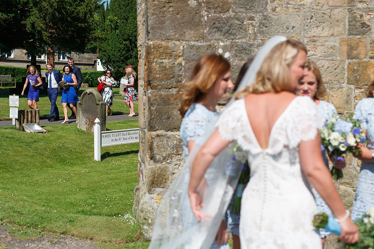 guests walk to greet the couple