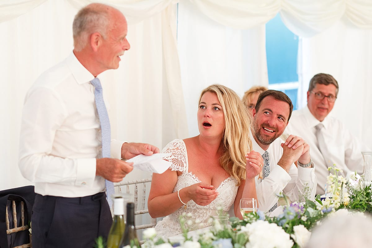 the father of the bride cracks a joke during his speech