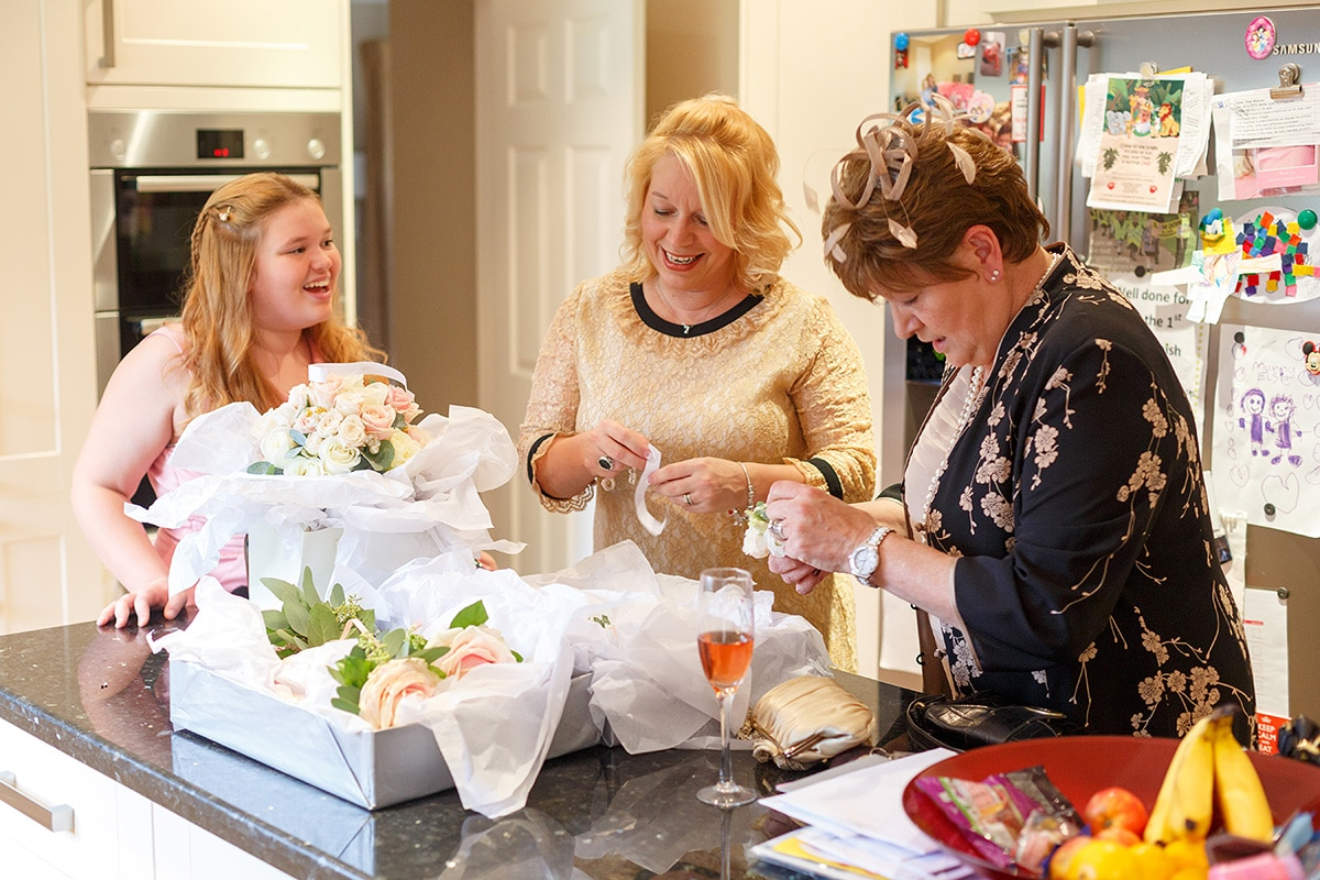 the brides mother fixeds the wedding flowers