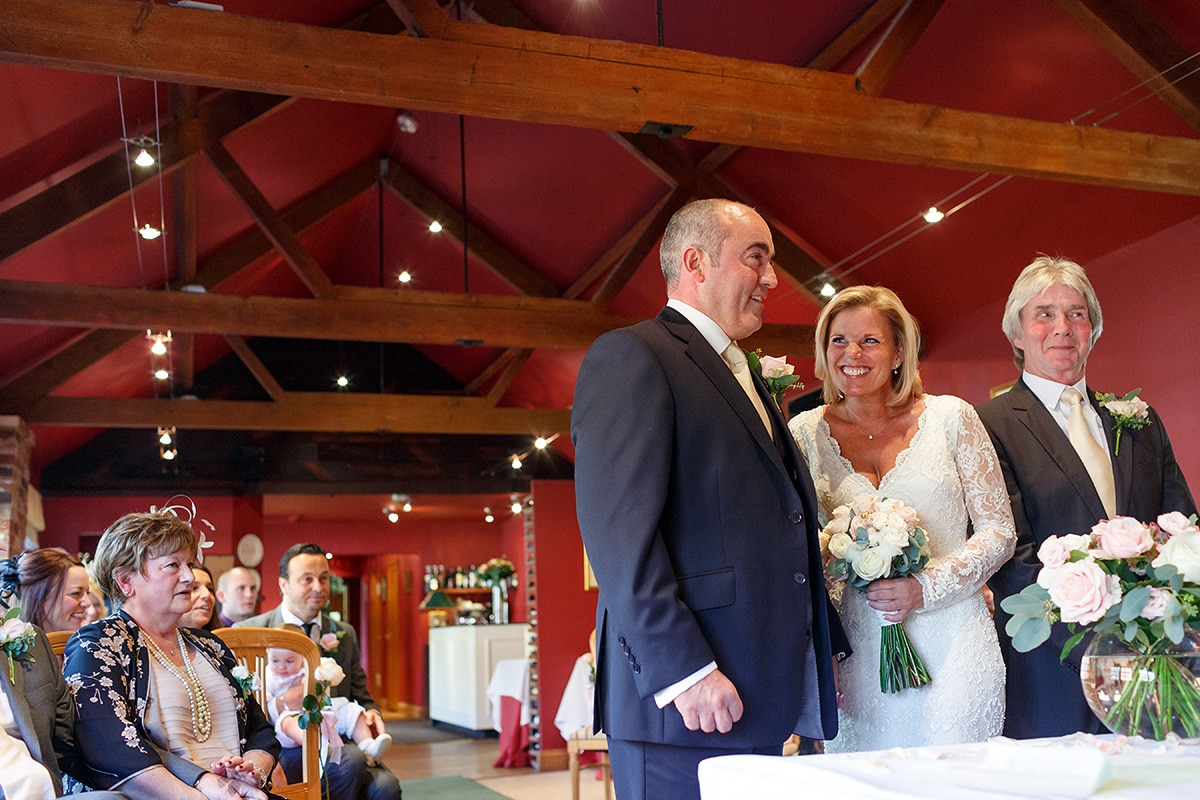 a happy bride and groom in brasteds ceremony room