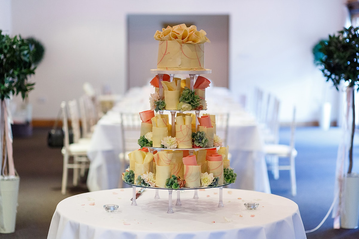 the wedding cake with the brasteds dining room in the background