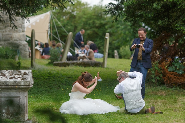 bride and groom hiding from the camera at their kent wedding