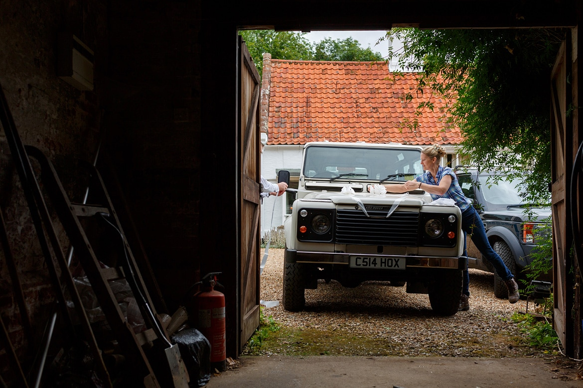 the bride dresses the landrover for the journey to her wedding at gressenhall