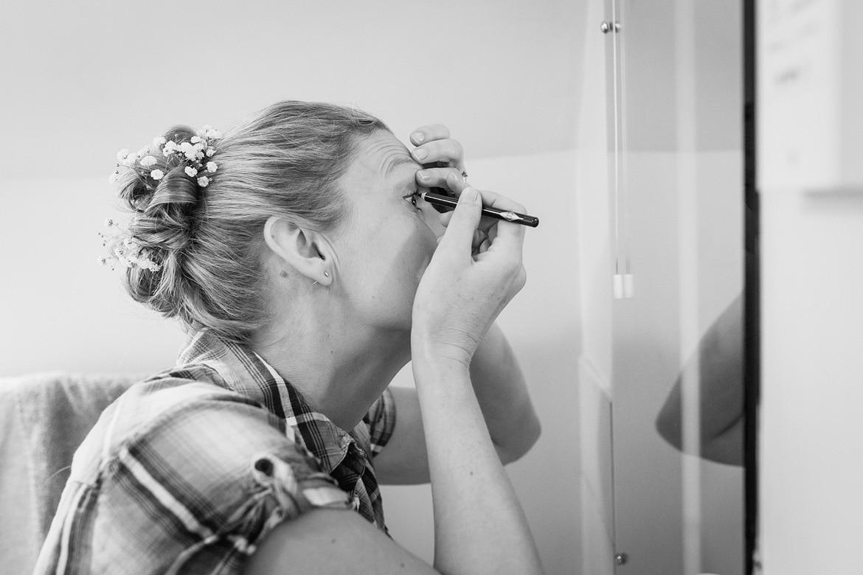 trixie applies her makeup