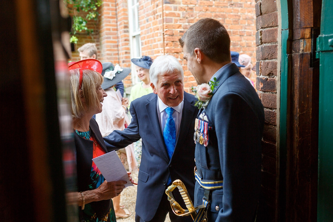 the groom greets guests at the gressenhall chapel