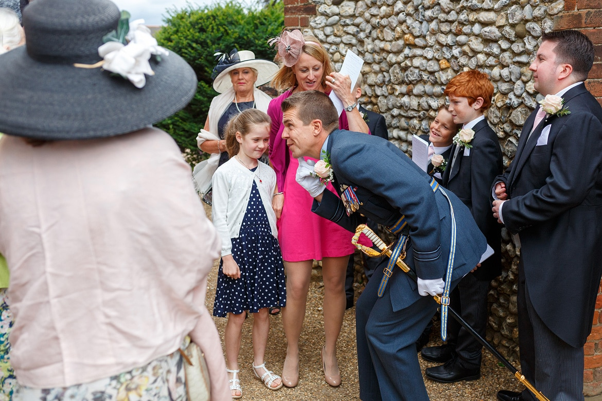 ben greets some children before the ceremony