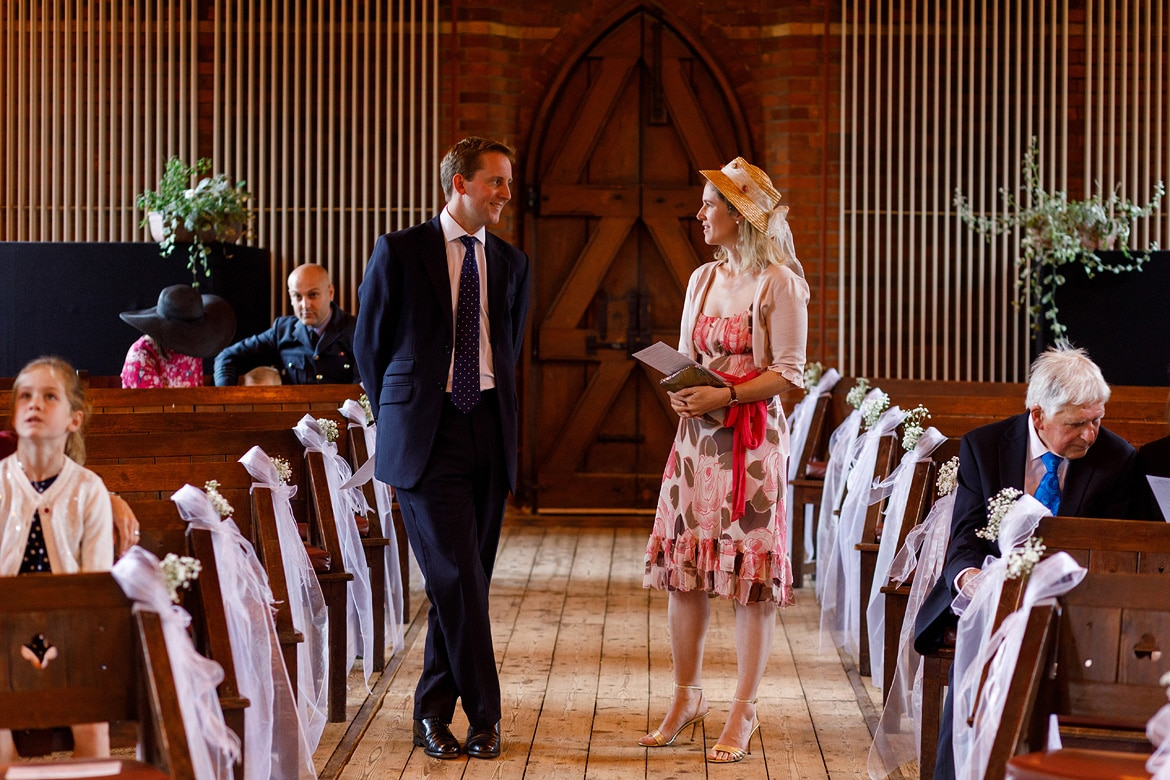 guests chat in the aisle of gressenhall chapel