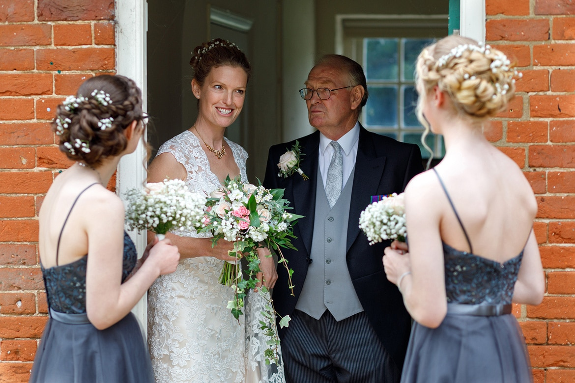 the bride and her wedding party before a gressenhall ceremony