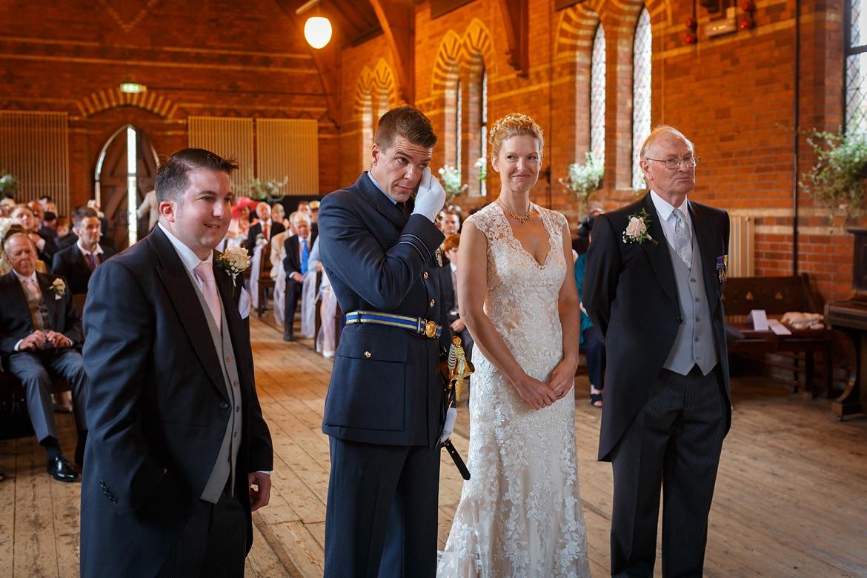 the groom wipes away a tear