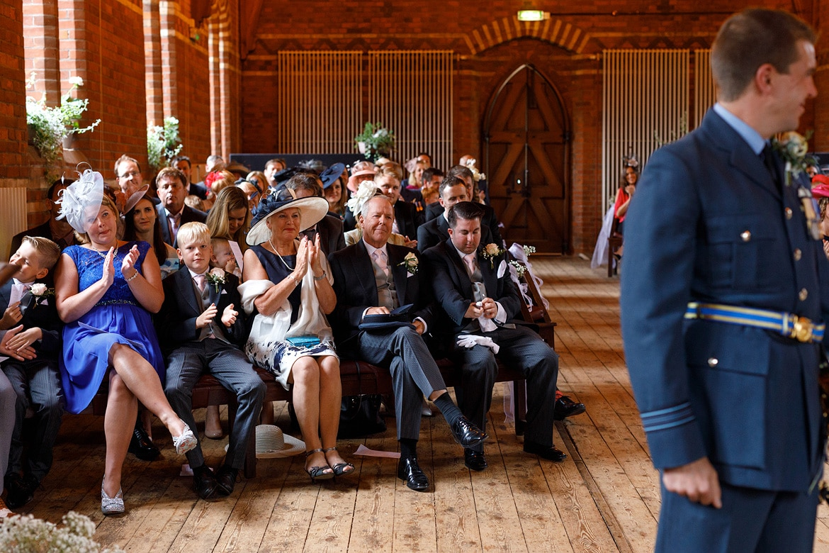 the grooms family look on during the ceremony