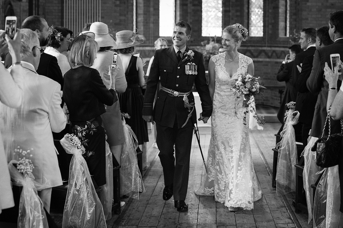 bride and groom walk down the aisle at gressenhall chapel