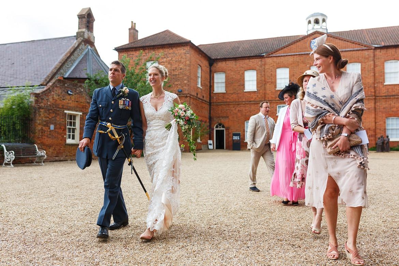 bride and groom walk to their wedding car