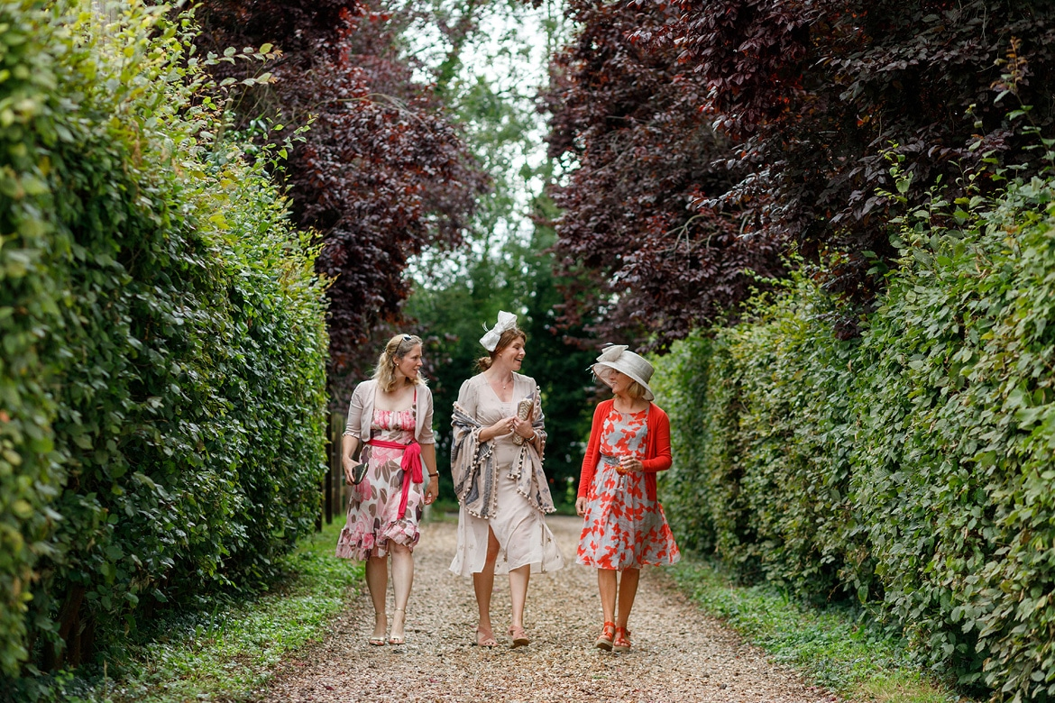 three guests walk down the drive