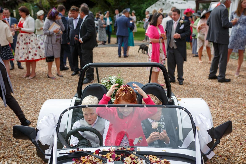 children play inside the wedding car