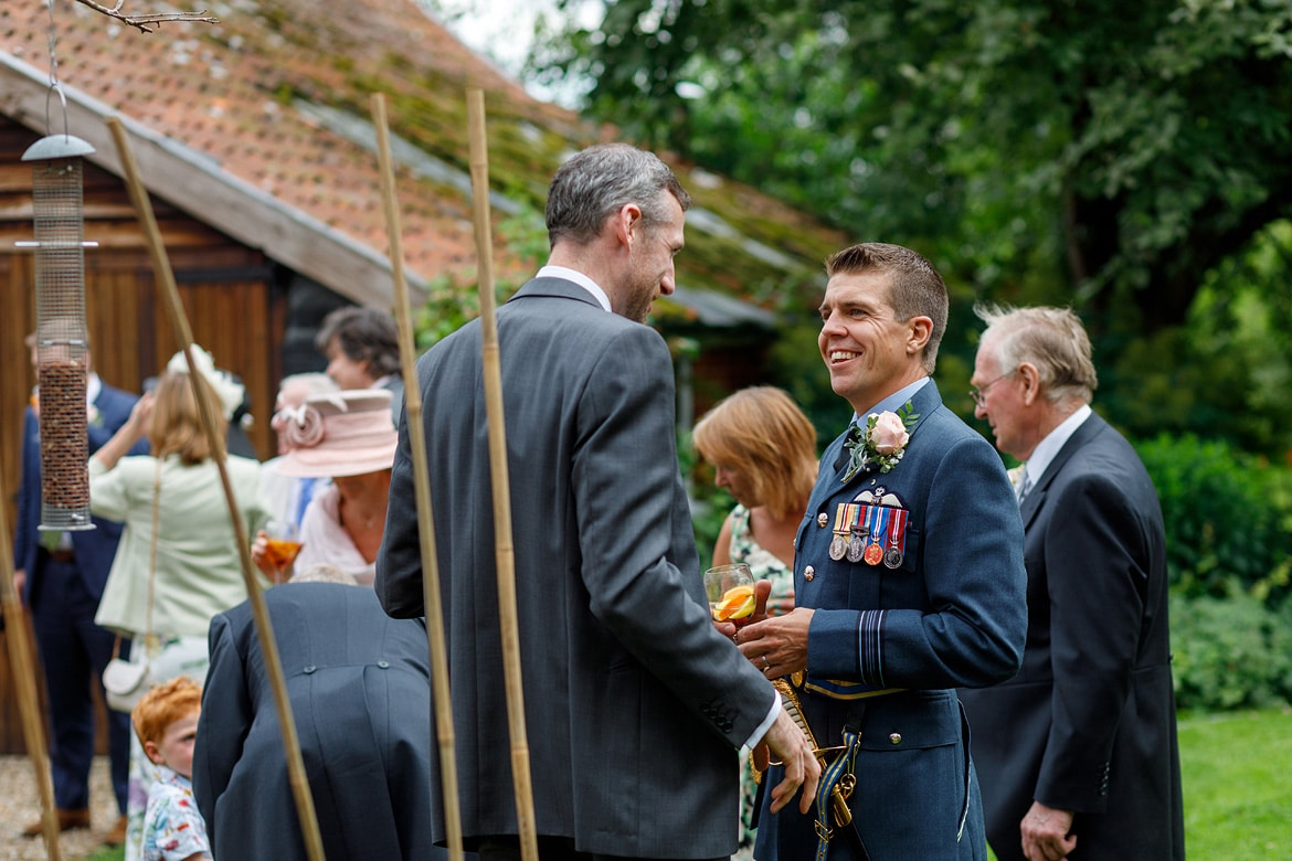 the groom talks to his guests