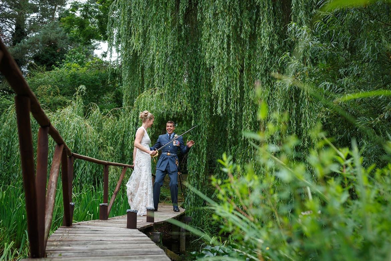 bride and groom on a bridge in the garden