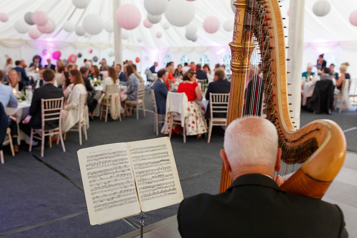 the wedding harpist in the marquee