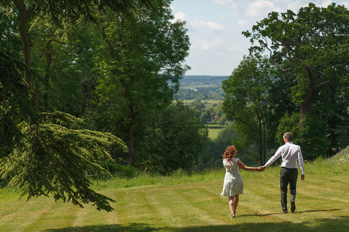 debbie and micoslav walk through the grounds of hedsor house