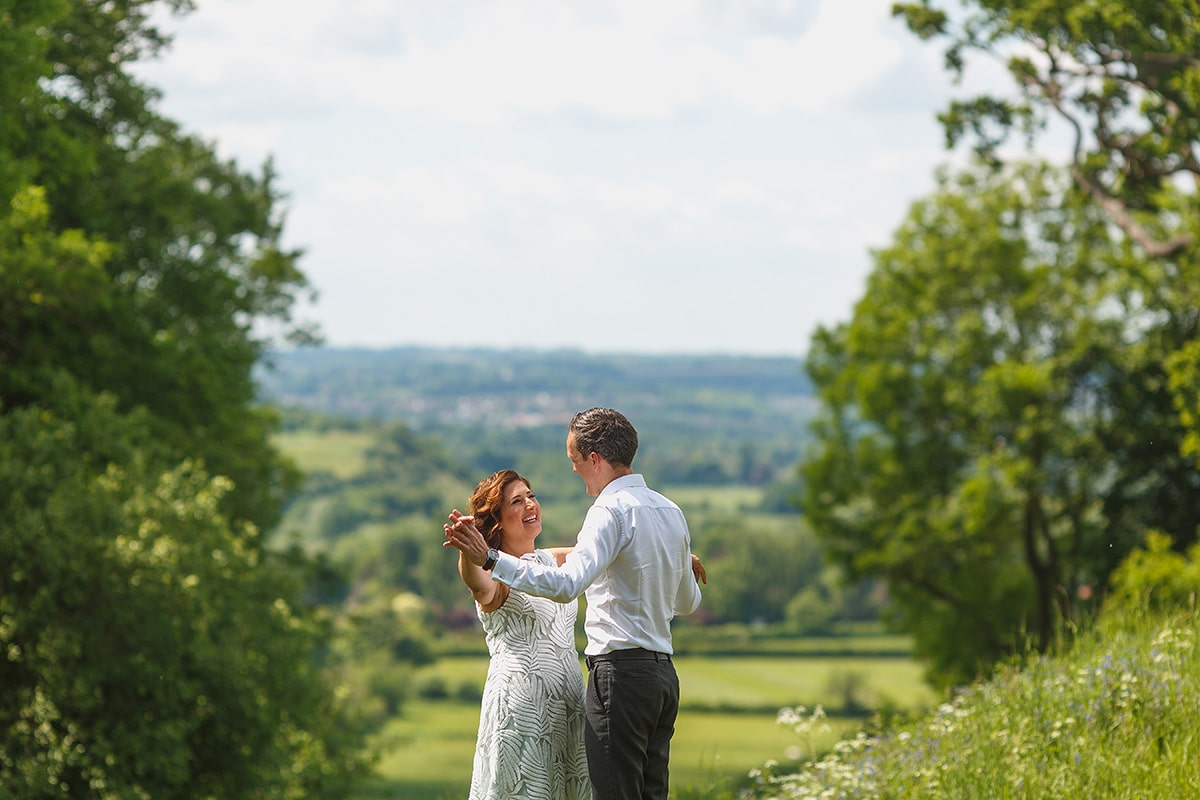 the couple with the buckinghamshire countryside behind