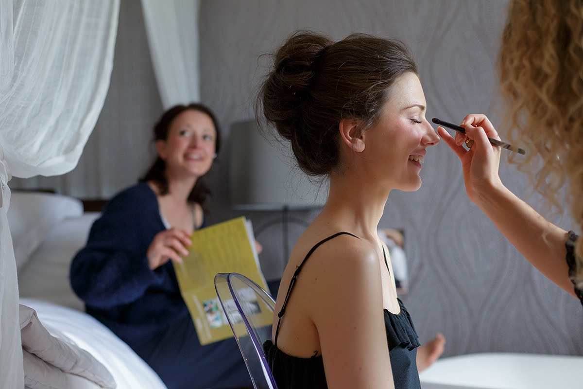 bride having her makeup done at godwick hall